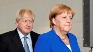 英国首相约翰逊与德国总理默克尔资料图片