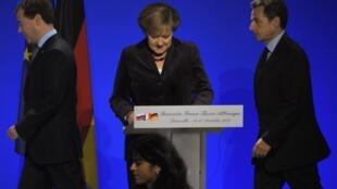 Главы трех государств на саммите в Довиле 19 октября 2010 г.