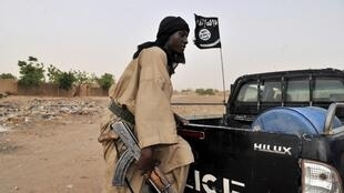 A fighter of an Islamist group Mujao patrols on 16 July, 2012 in Gao, northern Mali