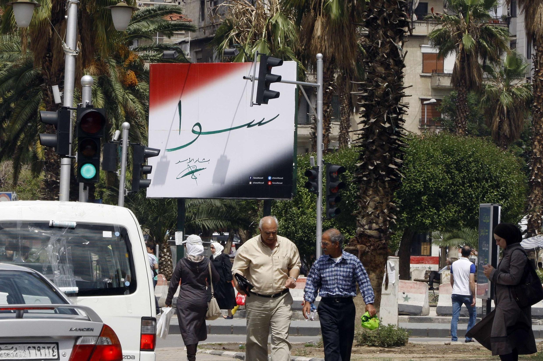 Cartaz com a campanha de Bashar Al-Assad nas ruas de Damasco neste domingo 11 de maio.