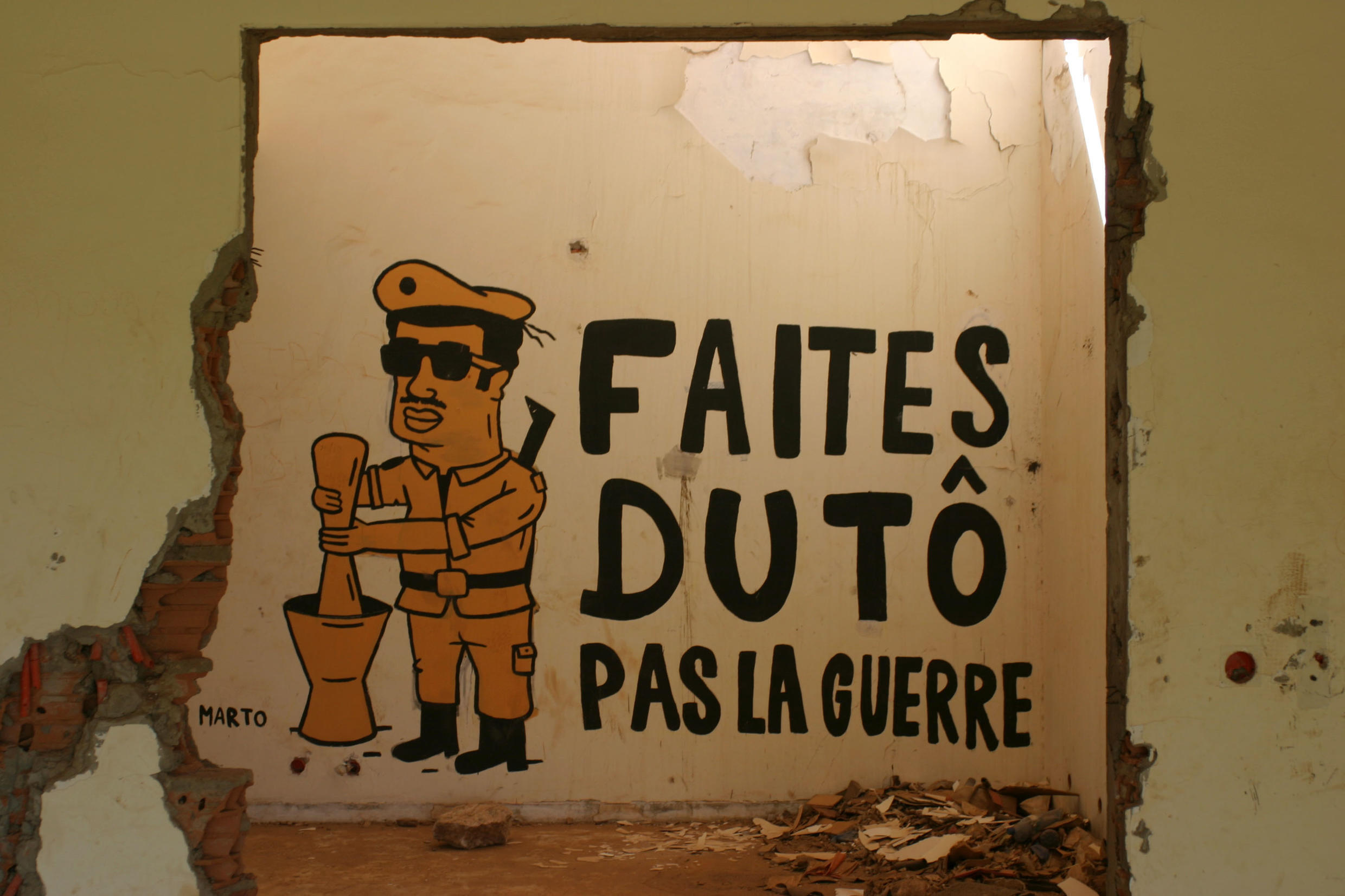 Marto's work in Francois Compaore's looted house. During the failed coup attempt there were fears fighting could break out between the presidential guard and army.