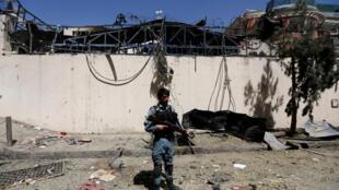 Un soldat monte la garde sur les lieux d'un attentat à Kaboul, Afghanistan, le 6 septembre 2016.