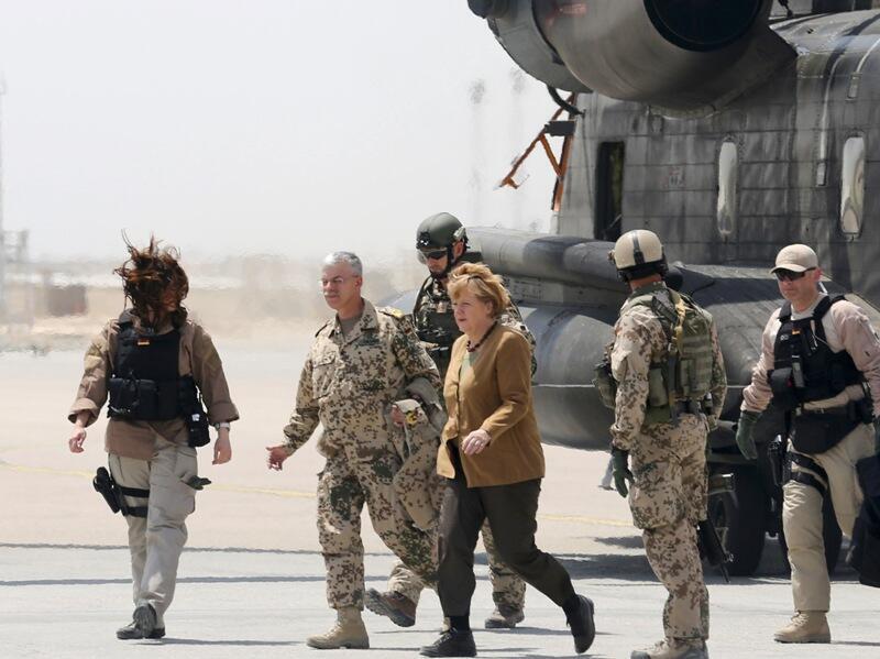 German Chancellor Angela Merkel walks after arriving to Mazar-i-Sharif, May 10, 2013.