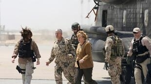 German Chancellor Angela Merkel walks after arriving to Mazar-i-Sharif, May 10, 2013.
