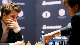 Sergey Karjakin of Russia makes a move against his opponent Magnus Carlsen  of Norway during round 12 of the 2016 World Chess Championship match in New York US on 28 November 2016.
