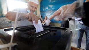2020-10-24T080711Z_1620344301_RC2WOJ9OTOUB_RTRMADP_3_EGYPT-ELECTION