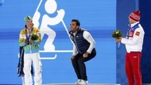 Gold medallist Martin Fourcade (C) at the Sochi Winter Olympics, 14 February