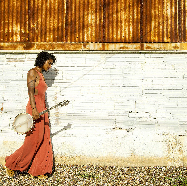Leyla McCalla with her trusty banjo