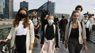 "Luisa Neubauer, Greta Thunberg and Adelaide Charlier (left to right) head to meeting with Merkel warning ""we are still in a state of denial"" on global warming"
