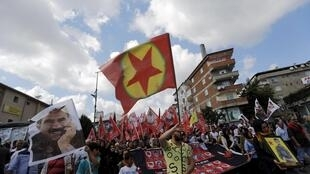 Protesters in Istanbul hail PKK flags and pictures of victims of the Suruc bombing