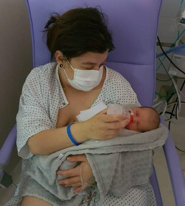 "Elodie, 26, gave birth to Charlotte in June in a hospital in Metz. ""It was horrible wearing a mask throughout delivery."""