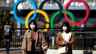 The International Olympic Committee says the spread of the coronavirus will not derail its plans to stage the Tokyo Olympics on time.