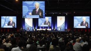 Former U.S. president Clinton makes a speech at a session of the 18th World Aids Conference in Vienna