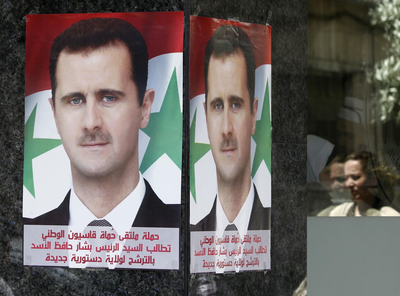 Cartaz apelando ao voto no presidente Bashar al-Assad