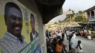 A poster of Haiti's presidential candidate Jude Célestin in a street market in Port-au-Prince