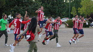 Atletico Madrid's players celebrate outside the Jose Zorilla Stadium after winning La Liga on Saturday.