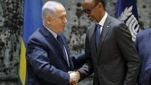 Rwanda's President Paul Kagame shakes hands with Israeli Prime Minister Benjamin Netanyahu during their meeting at the president's residence in Jerusalem on 10 July, 2017.