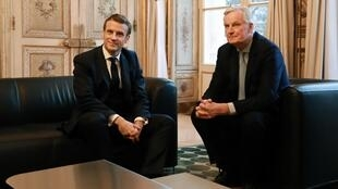 French president Emmanuel Macron (L) poses with European Commission Chief Negociator Michel Barnier prior to their meeting at the Elysee palace in Paris, on January 31, 2020, a few hours before Britain officially leaves the European Union.