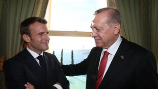 Turkish President Tayyip Erdogan meets French President Emmanuel Macron before the Syria summit