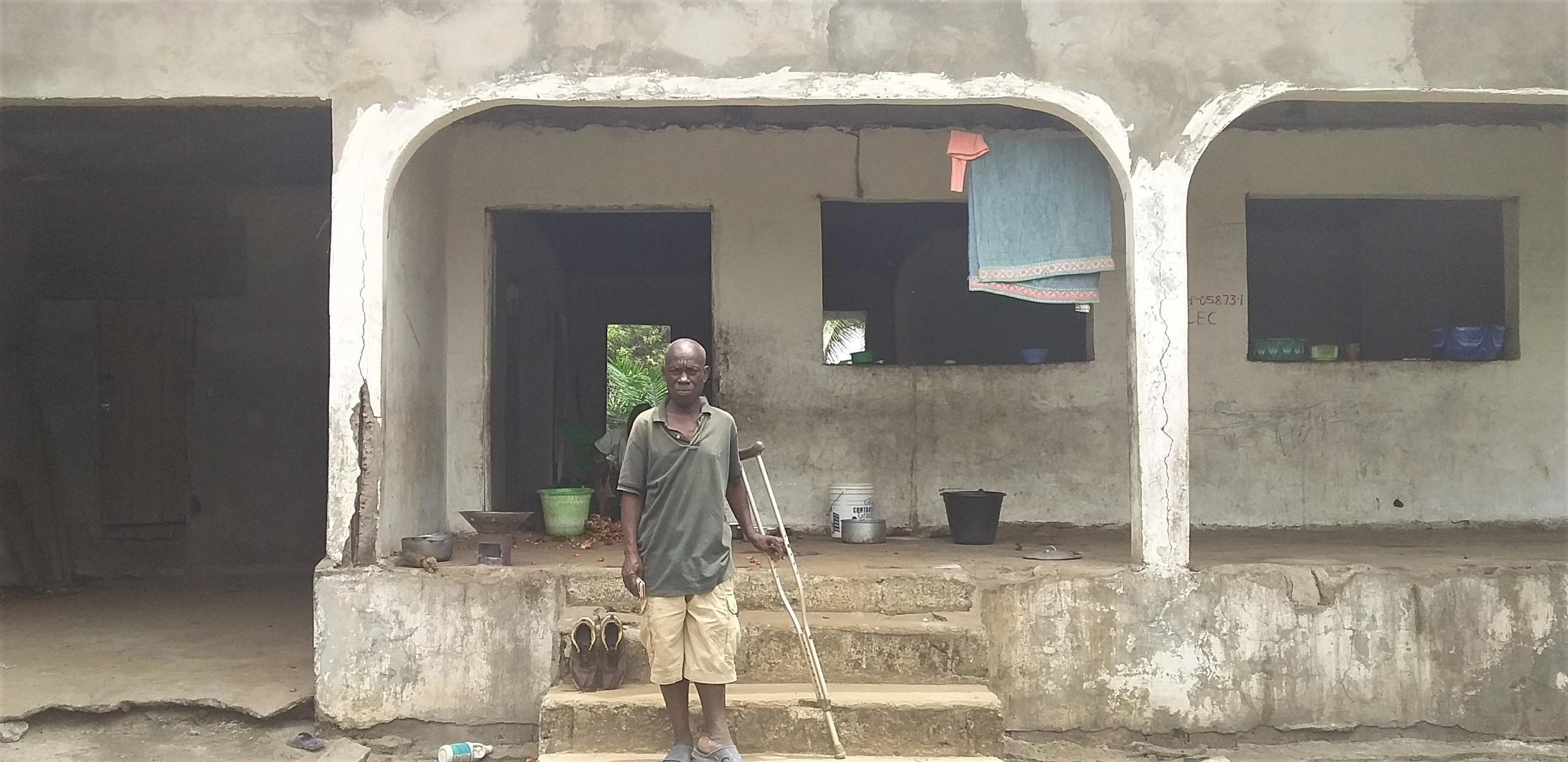 Rufus Kartee, age 52 standing infront an unfinished building within the Soul clinic comunity in Paynesville where he lives