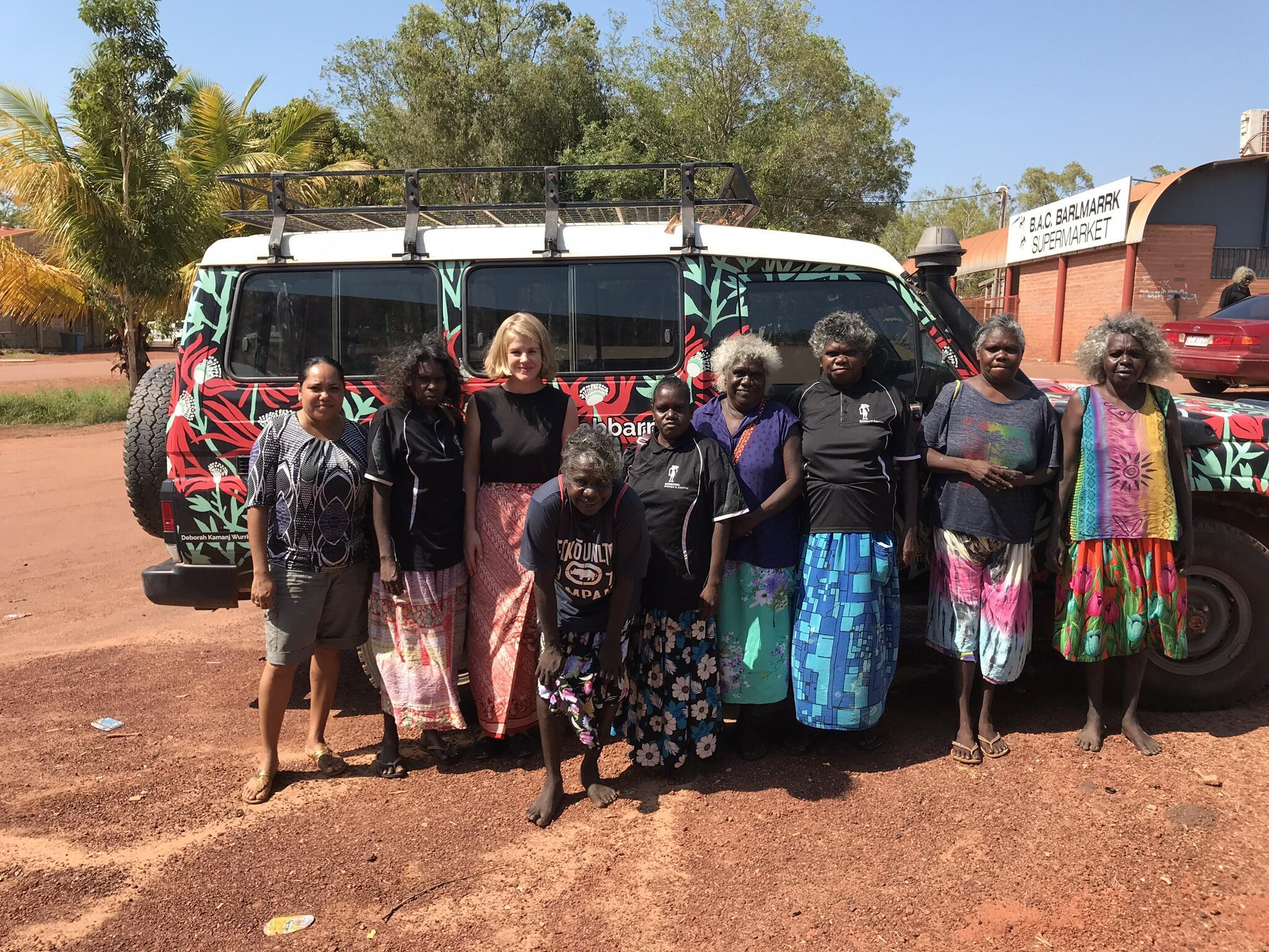 Artists from the Babbara Women's Centre with their jeep, in Maningrida, Northern Territory, Australia