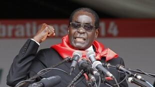 File photo of Zimbabwe President Robert Mugabe at his 90th birthday celebration in February 2014.