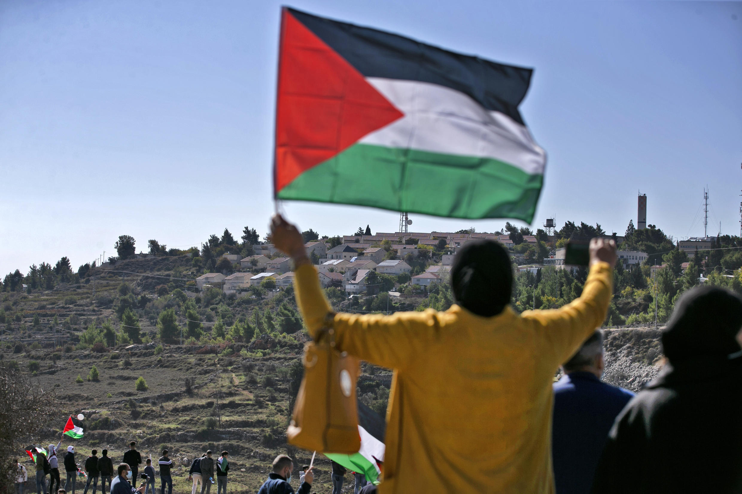 Palestinians demonstrate near the Israeli settlement of Psagot in the occupied West Bank, built on the lands of the city of al-Bireh, against the visit by US Secretary of State Mike Pompeo