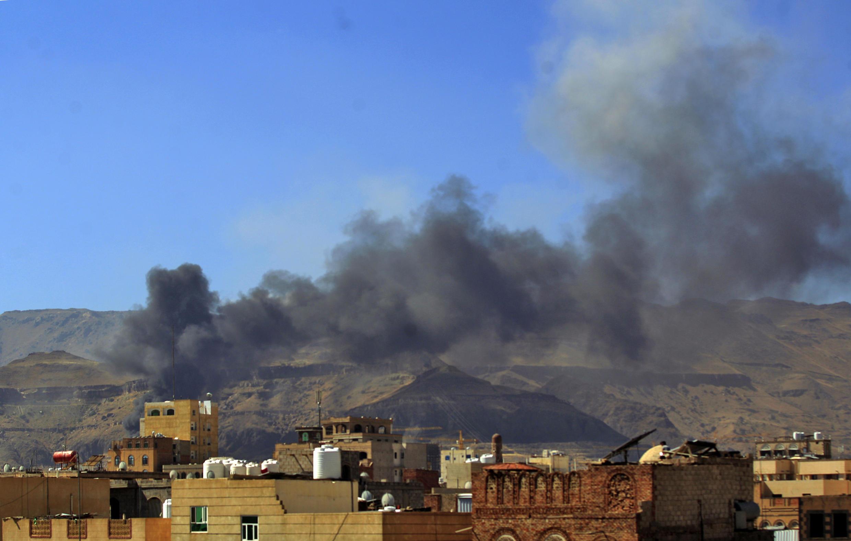 Smoke billows following an air strike in the Yemeni capital Sanaa on Friday