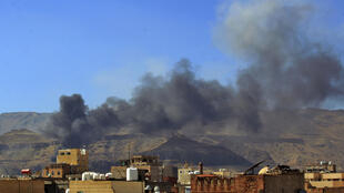 Smoke billows following an air strike in the Yemeni capital Sanaa on Friday