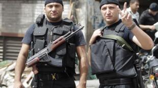 Des membres des forces de sécurité à Kerdassa, à l'ouest du Caire, le 19 septembre 2013.