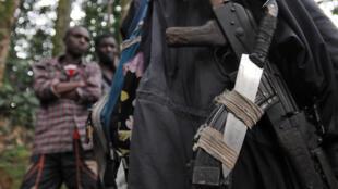 Waasi wa Kihutu FDLR wa Rwanda katika msituni karibu na kijiji cha Pinga, km 150 kaskazini magharibi mwa Goma,  Februari 2009.