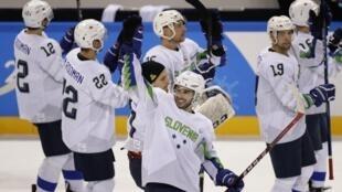 Ice Hockey – Pyeongchang 2018 Winter Olympics – Men Preliminary Round Match - U.S. v Slovenia - Kwandong Hockey Centre, Gangneung, South Korea – February 14, 2018 - Slovenia celebrates after defeating Team USA in overtime.