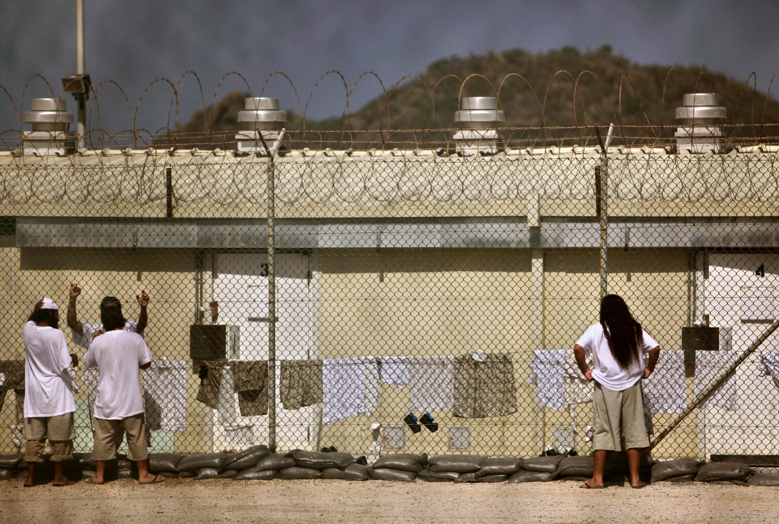 Detainees in the open-air yard at the Camp 4 detention facility at Guantanamo Bay in 2009