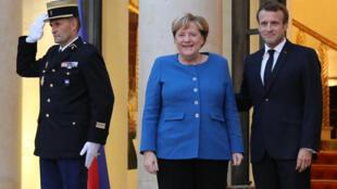 امانوئل مَکرون، رئیس جمهوری فرانسه، و آنگلا مرکل، صدراعظم آلمان، پاریس، کاخ الیزه - روز یکشنبه ١٣ اکتبر/ ٢١ مهرماه