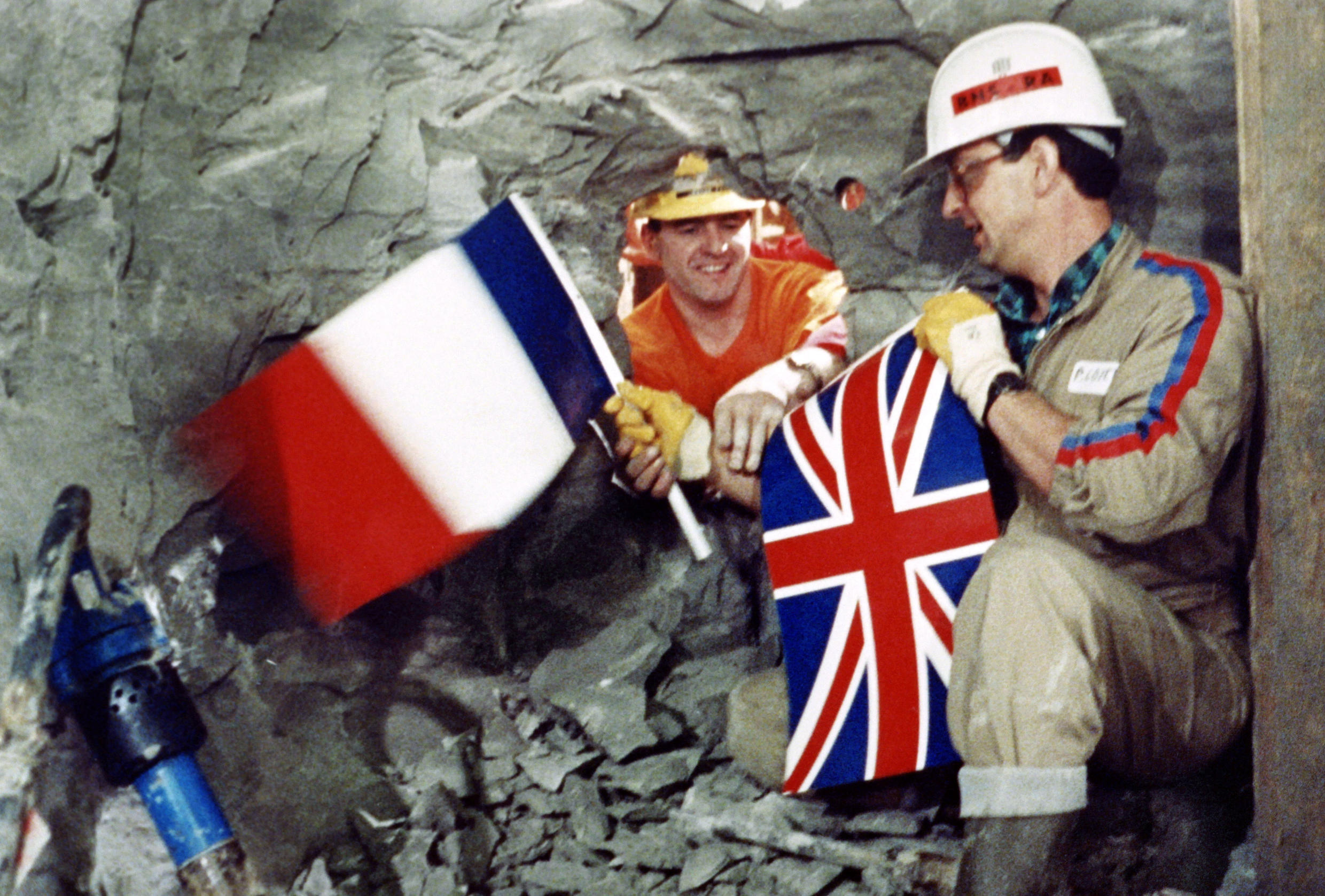 On 1 December 1990 tunnel workers Philippe Cozette (R) from France an Graham Fagg(L) from the UK meet under the Channel