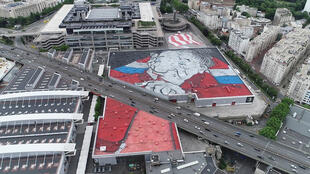 French artists Ella + Pitr spent eight days composing Europe's largest street art mural on the roof of a Paris convention centre.
