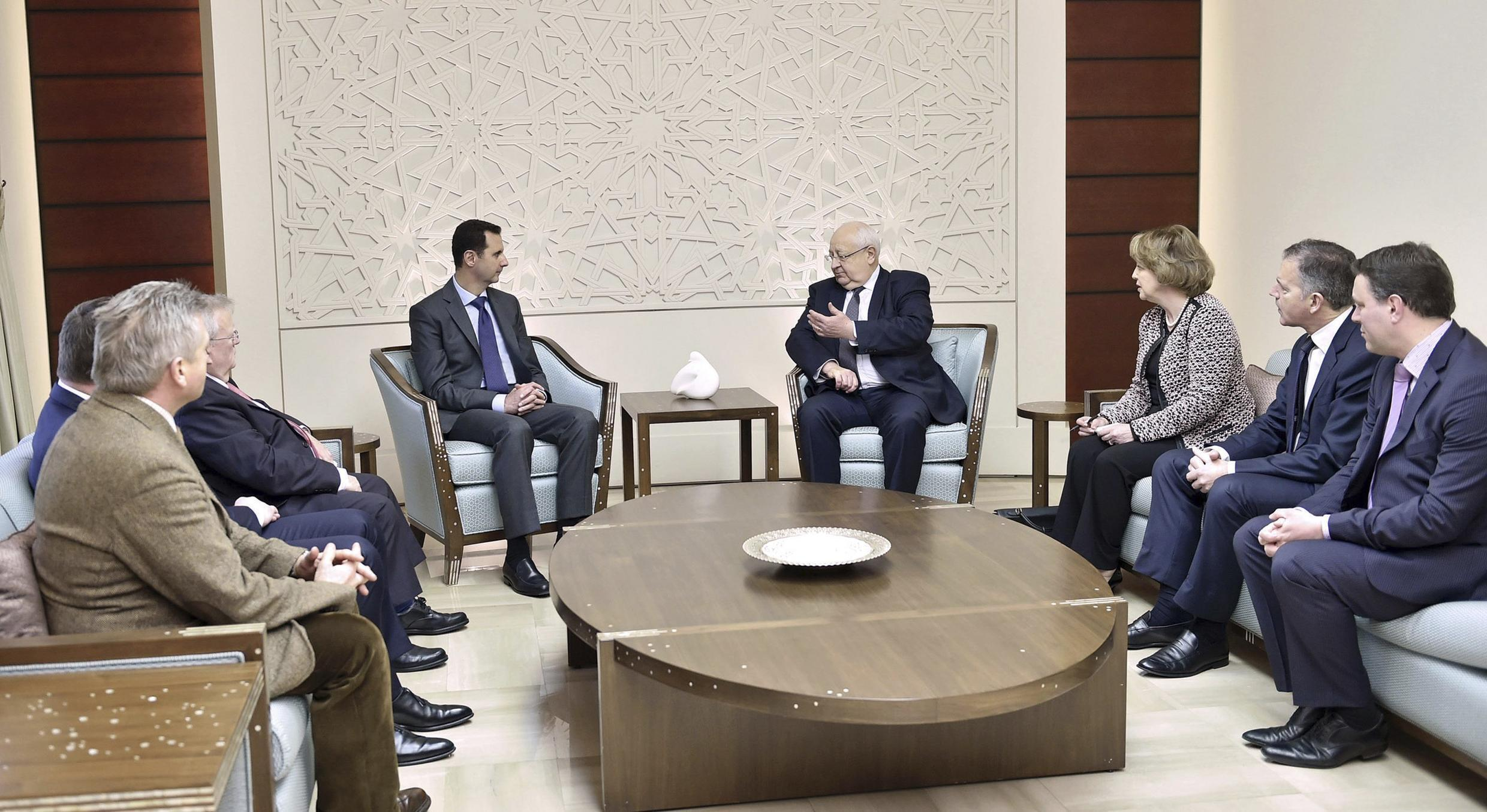 Syrian President Bashar al-Assad with the four French MPs who visited Damascus in February