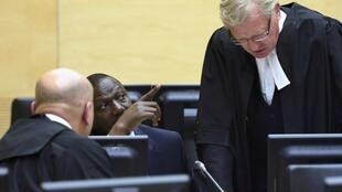 Kenyan William Ruto sits in the courtroom of the International Criminal Court in The Hague, 14 May, 2013
