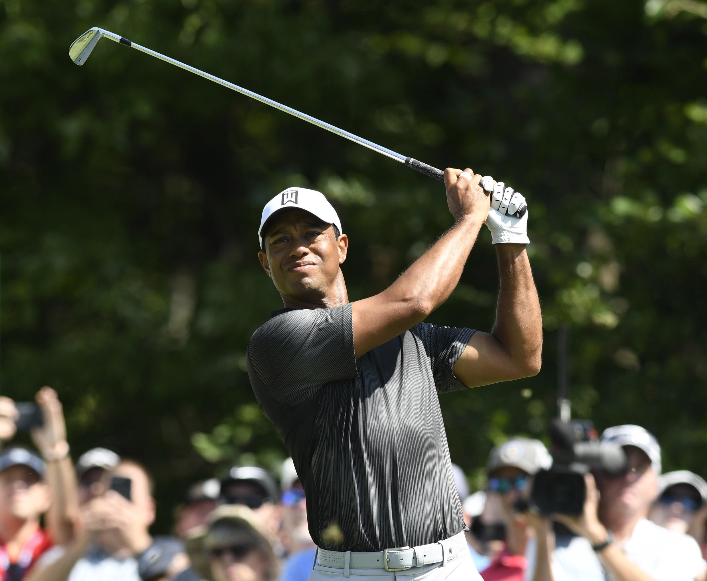 Sep 2, 2018; Norton, MA, USA; Tiger Woods hits his tee shot on the 1st hole during the third round of the Dell Technologies Championship golf tournament at TPC of Boston.