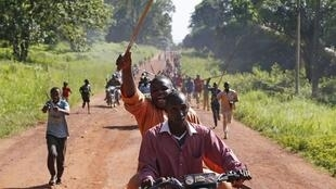 A man waves a machete at a protest against French troops in Bambari earlier this month