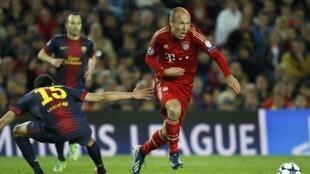 Dan wasan Bayern Munich Arjen Robben ya sha gaban 'Yan wasan Barcelona a gasar zakarun Turai da kungiyoyin biyu suka buga a zagayen kusa da karshe.