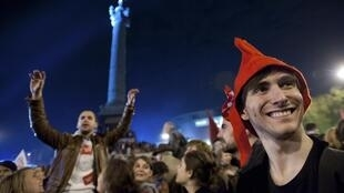 Supporters of France's newly-elected President Francois Hollande celebrate during a victory rally at Place de la Bastille