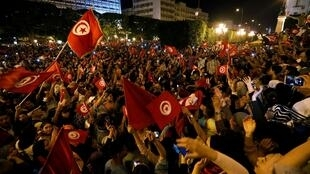 Crowds gather in the centre of Tunis to celebrate the probable victory of Kais Saied, 13 October 2019.