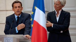 Nicolas Sarkozy and Christine Lagarde at a press conference in August 2009.