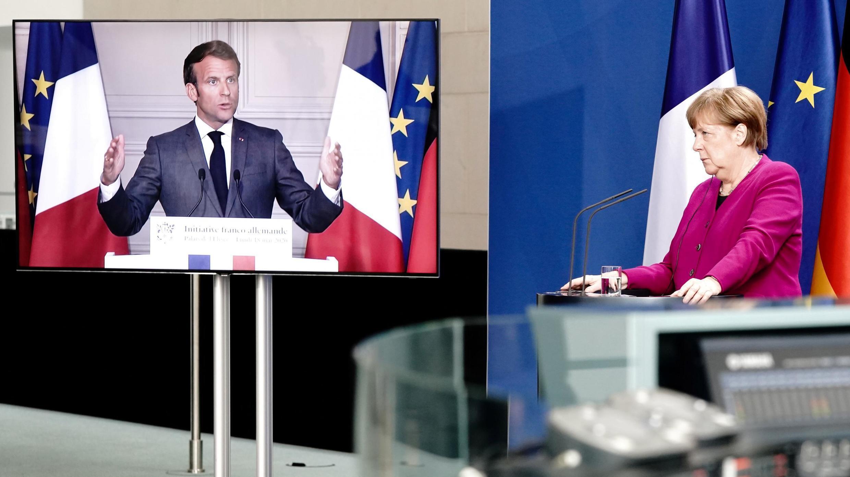 La chancelière allemande Angela Merkel (à droite) en visioconférence avec le président français Emmanuel Macron, le 18 mai 2020.