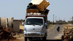 Civilians flee fighting in Syria's Daraa province in June
