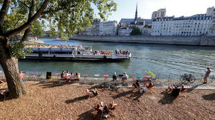 Parisians subathe on the banks of the Seine on Saturday