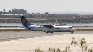 An Israir Airlines flight from Tel Aviv lands at Cyprus's Larnaca International Airport, the first scheduled commercial passenger flight to arrive on the island since the imposition of a coronavirus lockdown on March 21