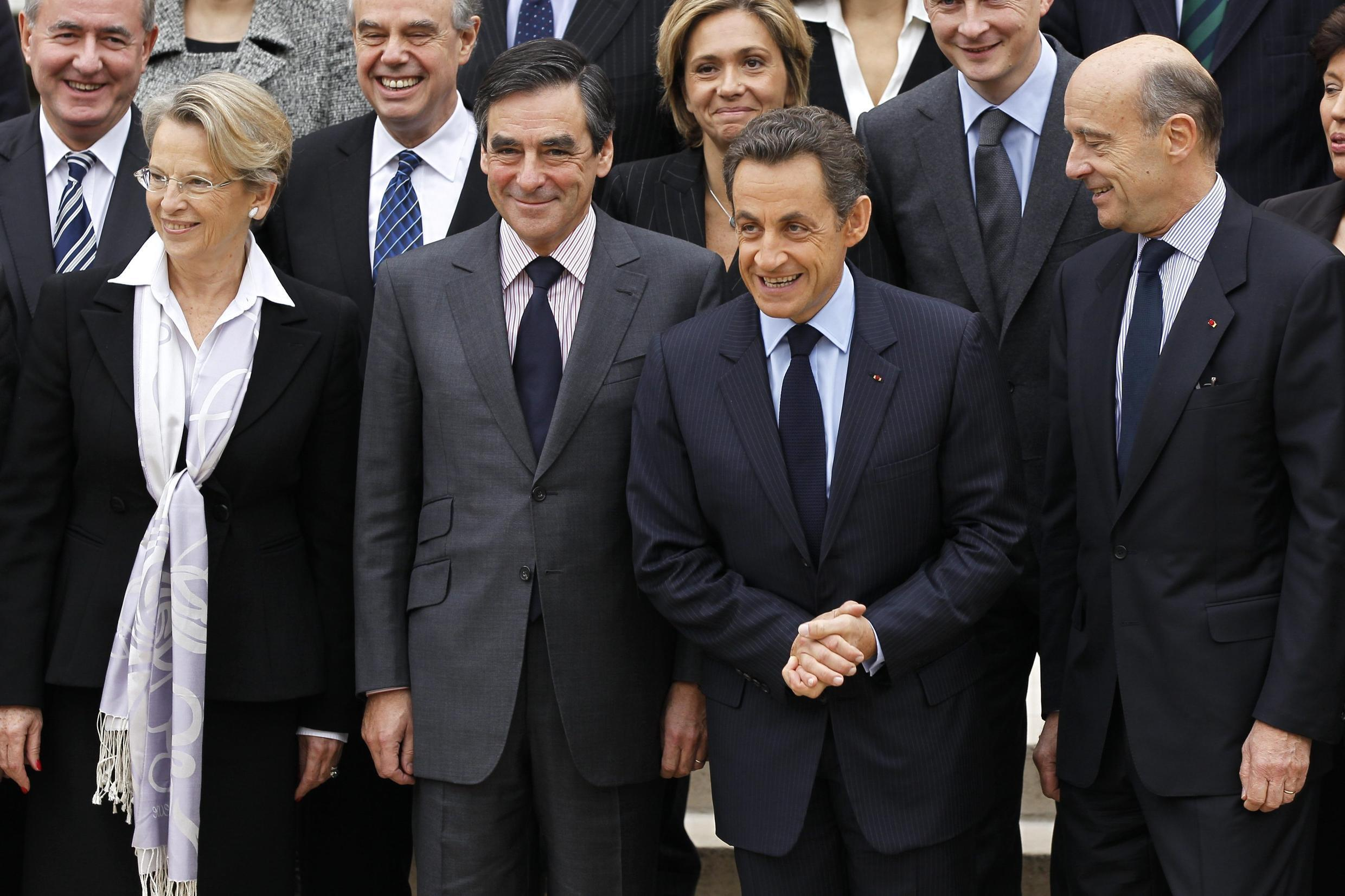 France's new government poses for a family picture at the Elysee Palace in Paris