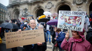 "French pensioners protest against government plans to reform pension system, in Paris, France, September 28, 2017. The placard (R) reads: ""Lazy pensioners, but not cash cows"""